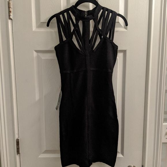 bebe Dresses & Skirts - NWT BEBE Black strappy bodycon dress XS